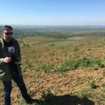 Peter drinking Feteasca Neagre on Minis hill vineyard